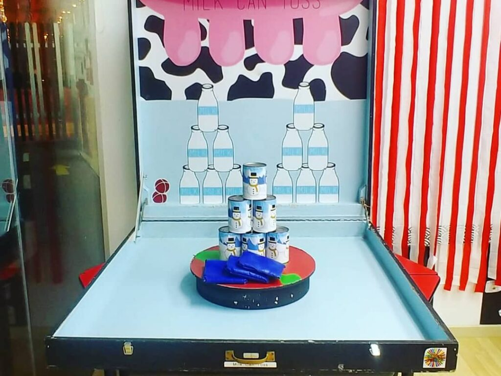 Milk cans toss carnival games rental singapore